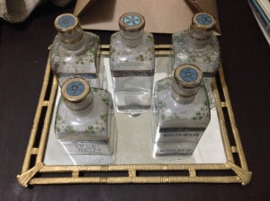 Vintage glass bottles with stoppers atop a mirrored tray make a lovely dresser or vanity set.